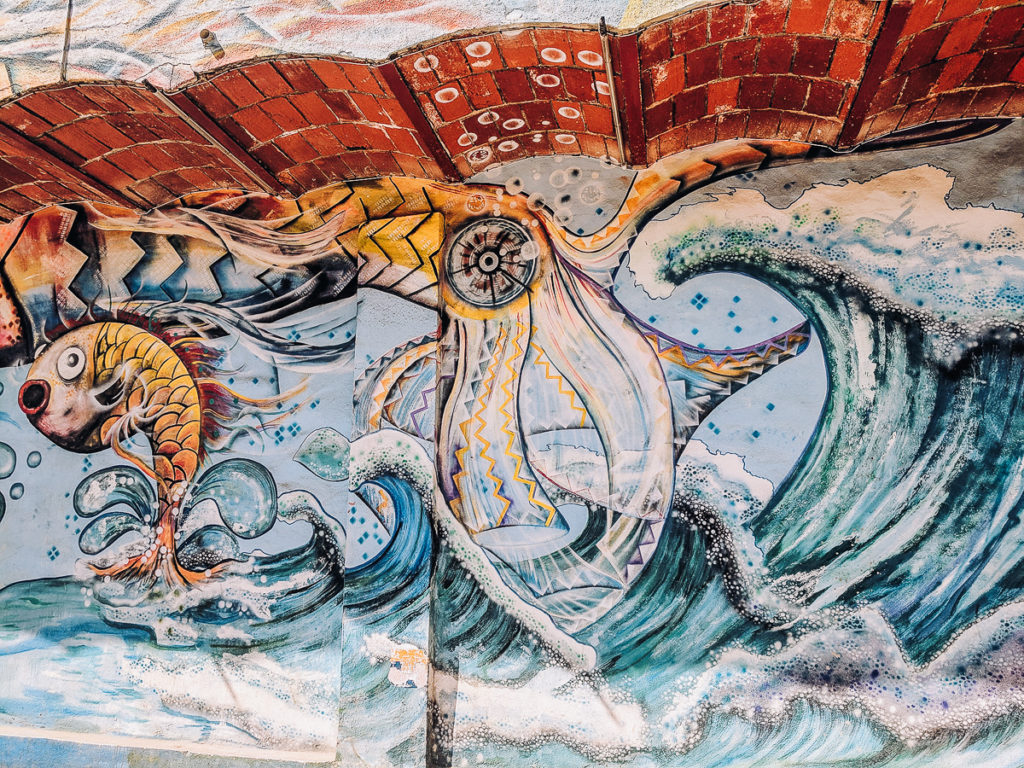 a Fish and wave are part of this street art in Sayulita