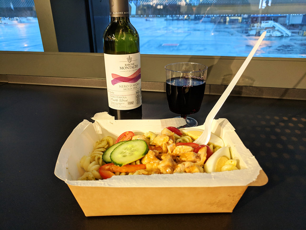 Pasta and wine at the KEF airport in Iceland
