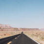 highway passing in front of the Vermilion Cliffs