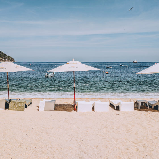 Umbrellas in the sand in Yelapa, Jalisco Mexico
