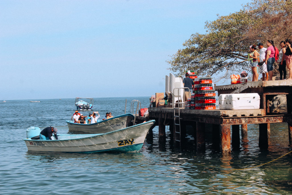 Boats in Boca de Tomatlan getting ready to take food and provisions to the other beaches