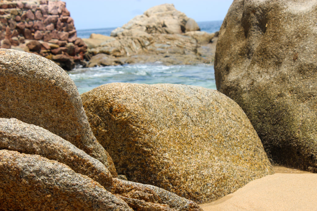 Rocks and boulders line the beach at Mismaloya