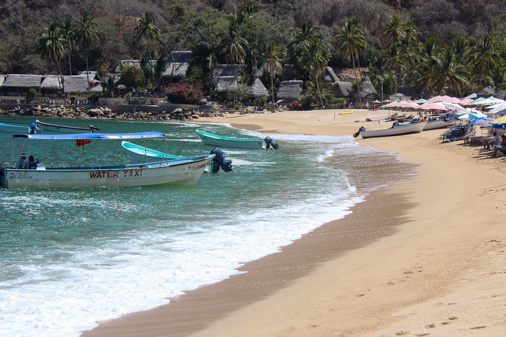 Boats line the beach in Yelapa and should be included in your day trips from Puerto Vallarta