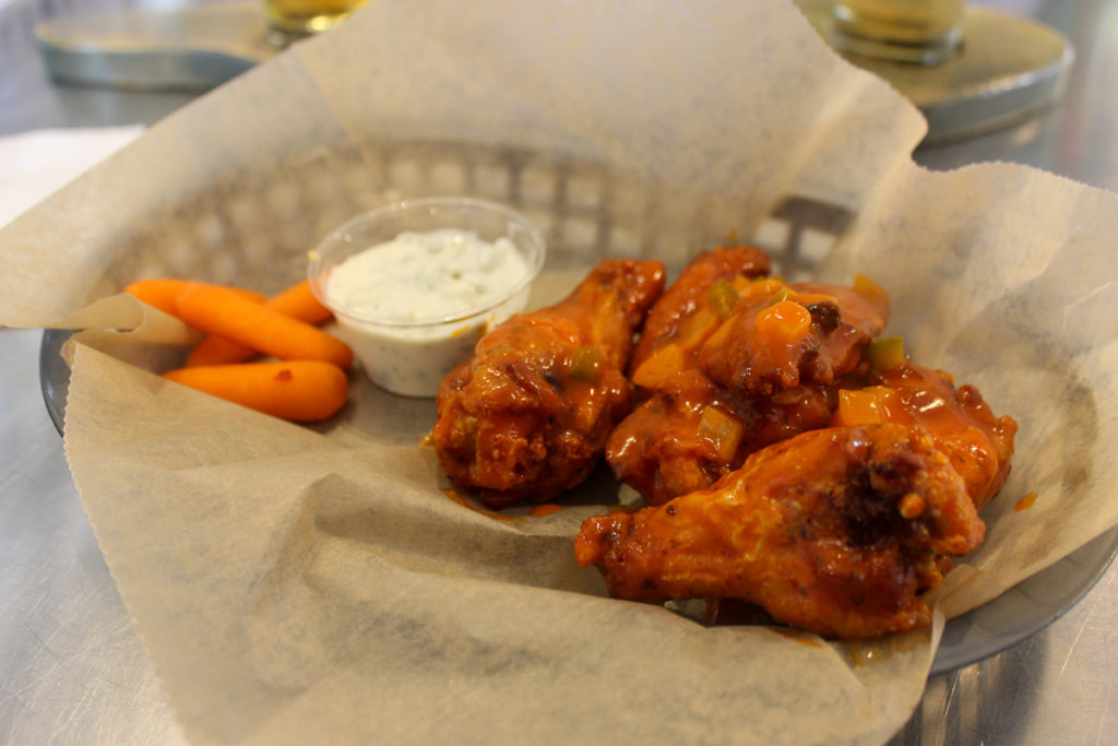 A plate of wings at Flyway Brewing Little Rock's Locally Labeled